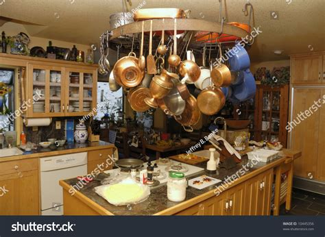 Hanging Pots And Pans Island A Well Used Kitchen With Pots And Pans Hanging From Wheel