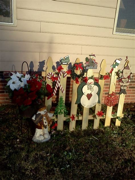 ideas for decorating iron fence posts for christmas outdoor fence decorations