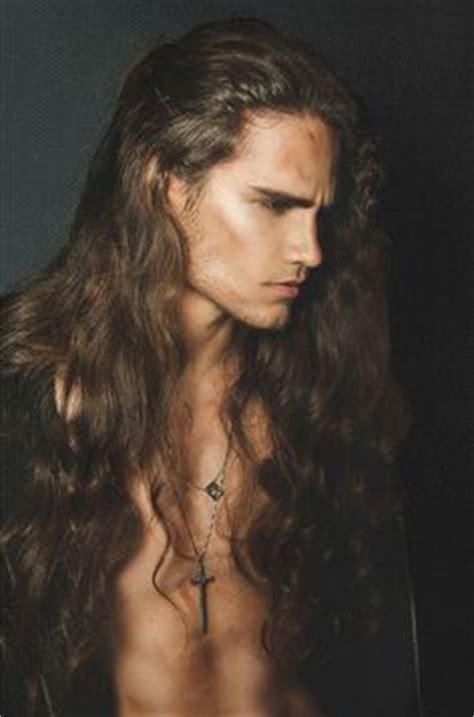 man angel with curly hair douglas hickmann long hair beards and man buns