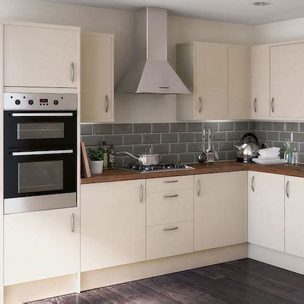 cream kitchen with grey tiles and wooden worktop   Google