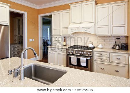 luxury kitchen with white cabinets and oyster counters