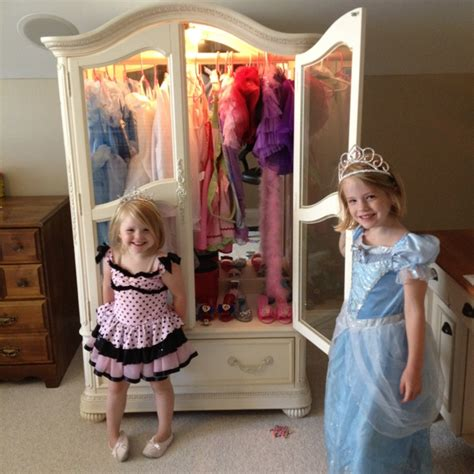 girls dress up armoire garage sale armoire turned into a dress up center with a simple wooden dowel get