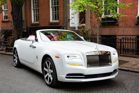 rolls royce white convertible screendrive the 400 000 rolls royce dawn plays it safe