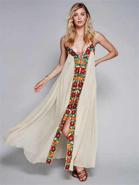 Wst 10888 Embroidered Tunic Dress 1 dress free flowing maxi dress with beautiful floral embroidery the front and a