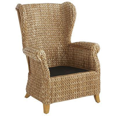 seagrass wingback armchair temani ottoman antique parchment chairs wings and