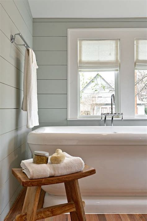 shiplap gray restful bathroom with shiplap clad walls painted gray