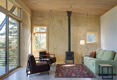 Plywood Interior Wall Finish by Plywood Walls Grey Floor White Wall And Green Sofa