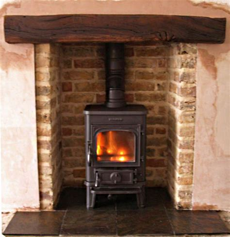 reclaimed brick fireplace also provided reclaimed beams 25 best ideas about slate hearth on wood