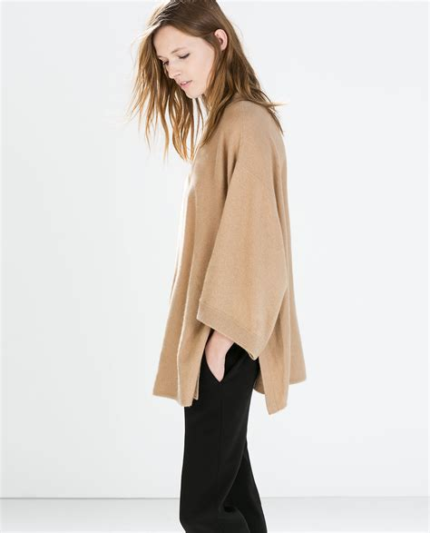Zeera Khasmeer zara poncho with side slits in lyst