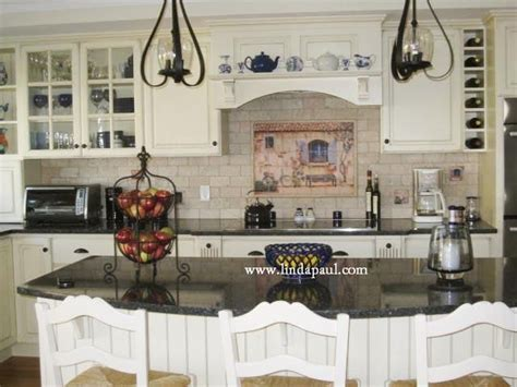 pictures of country kitchens with white cabinets country kitchen with white cabinets and black