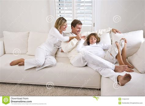 family sofa family relaxing at home on white living room sofa stock