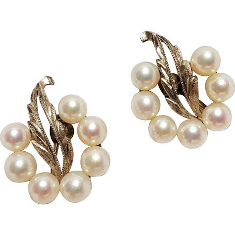mikimoto silver earrings akoya pearls from green mannequin