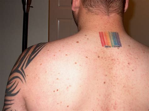 property of us army barcode tattoo on man side neck