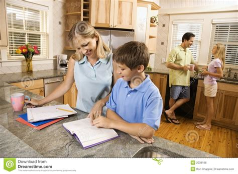 family kitchens kitchens that are friends for kids family in kitchen doing homework stock photo image 2038168