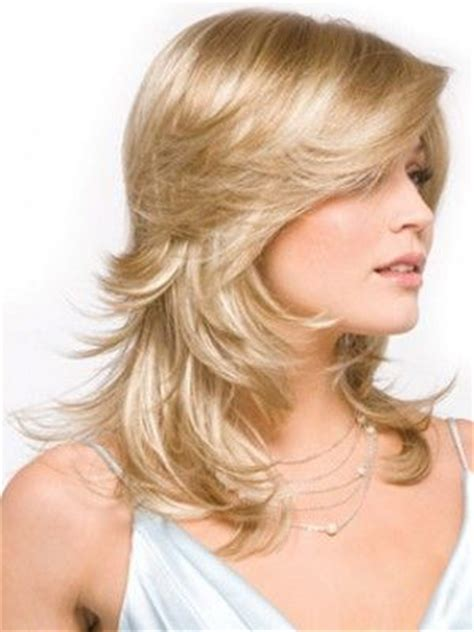 feathered back hairstyles for women long feathered layers i love the top layers how they
