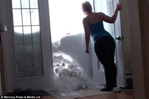 through wall door plume the cat smashes through wall of snow to get dinner in ethiogrio