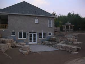 Walkout Basement Walkout Basement With Limestone Tiered Retaining Walls For Our House Walkout