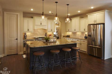 staggered kitchen cabinets regency homebuilders open concept living large kitchen