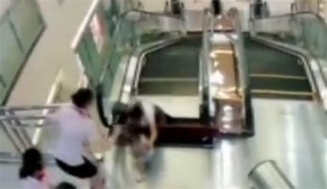 crushed by escalator china escalator accident mom killed by escalator in