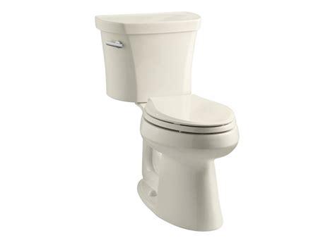 kohler comfort height toilet specs kohler k 3949 47 almond 1 28 gpf two piece comfort height
