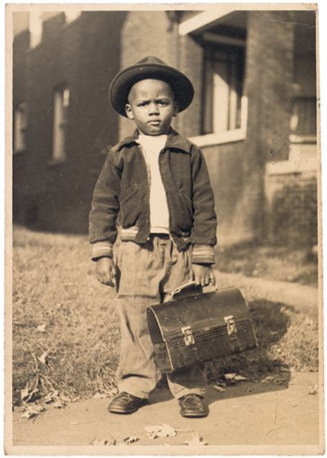 photograph of boy with lunchbox