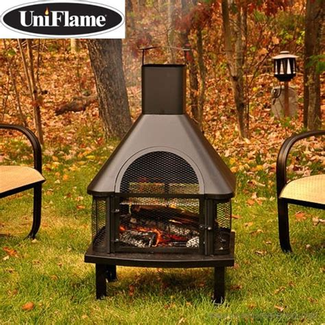 outdoor fireplace grate uniflame wood outdoor fireplace featuring a grate