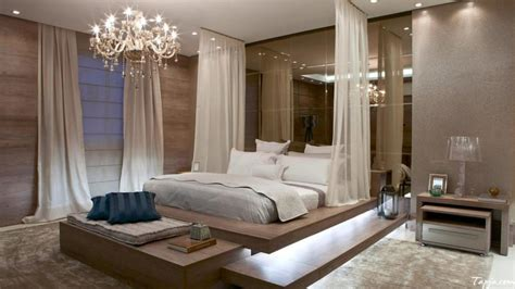 modern bedroom decor images bedroom decoration for better sleep water viviana ioan 16241 | luxury modern bedroom decoration with crystal chandelier and white curtain along with led lighting under the bed including brown rug on floor and mirro decor on the wall 1024x575