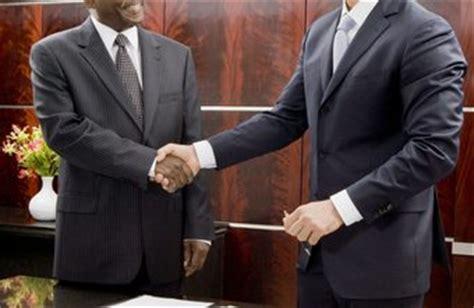 sports agent job description see businessmen signing papers
