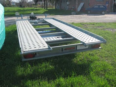 cerco carrello porta auto usato trasporto barca vela gommone noleggio carrelli restauro