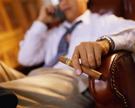 Prepare Resume Online For Free by Businessman Having A Cigar