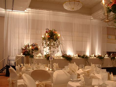 head table with two rows and tulle draping lansing center