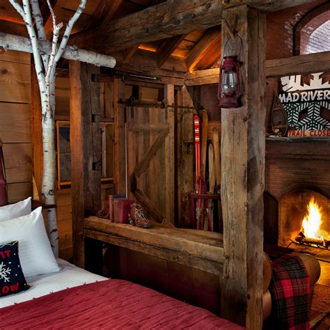 hotel with log fire in bedroom inside a stylish and cozy vermont ski lodge airows