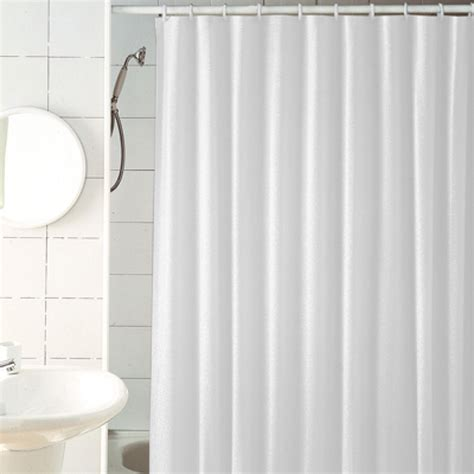 bathtub with shower curtain following feng shui to a better bathroom
