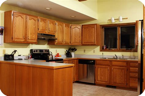 yellow kitchen walls with oak cabinets wall colors for oak cabinets bungalow home staging