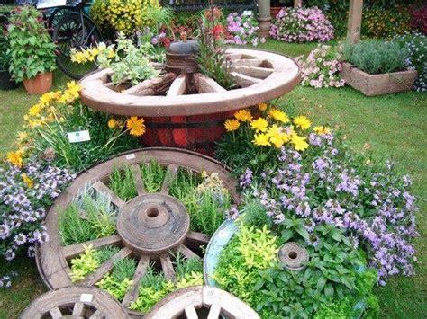 1000 Images About Wagon Wheel Planter Ideas On Pinterest Wagon Wheel Planter