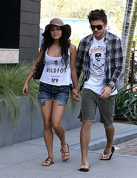 zac efron hands zac efron and vanessa hudgens go shopping in matching