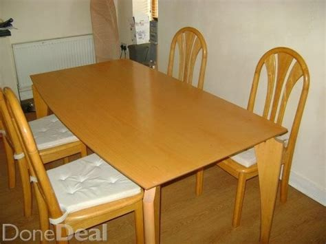 solid wood kitchen table and four chairs for sale in bray