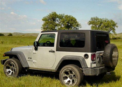 jeep wrangler 2 door hardtop black types of jeep wrangler tops how to care for them