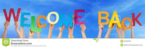 Character Building Letter hold colorful word welcome back blue sky stock photo