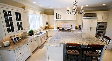 Giallo Ornamental Light Granite White Cabinets by Backsplash And Giallo Ornamental Granite Kitchens