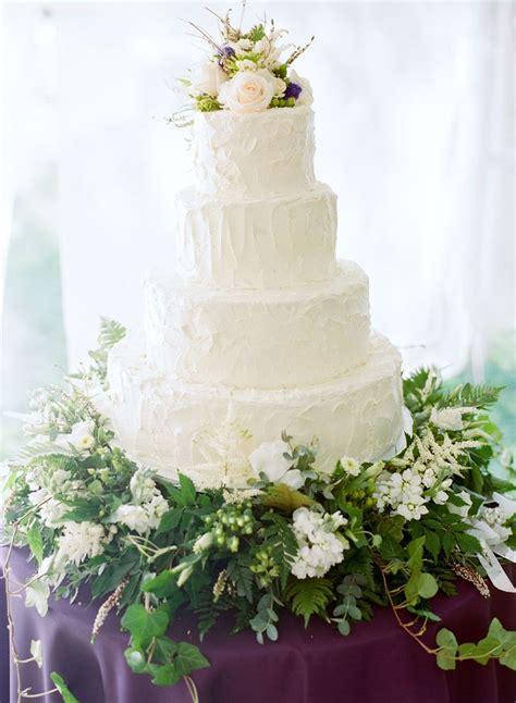 Wedding Cake Greenery by 4 Tier White Wedding Cake With Sprawling Greenery