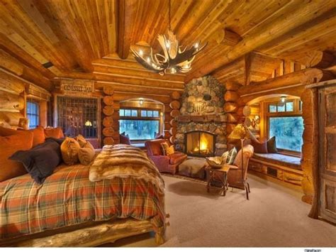cozy log cabin bedroom  fireplace   rustic