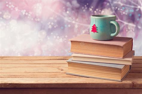 how many copies of a cup of christmas tea sold cup of tea and vintage books on wooden table beautiful winter bokeh background