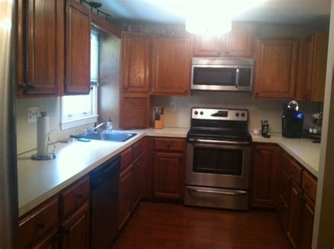 best way to update kitchen cabinets whats the best way to update oak kitchen cabinets