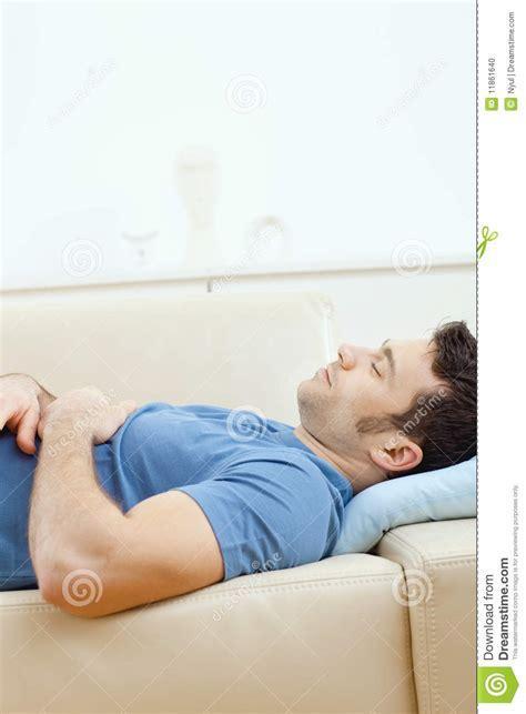 man sleeping on couch man sleeping on couch stock photo image 11861640