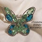 Syari Buterfly Blue stunning jour light topaz blue and sapphire color rhinestone butterfly from vintageshari on ruby
