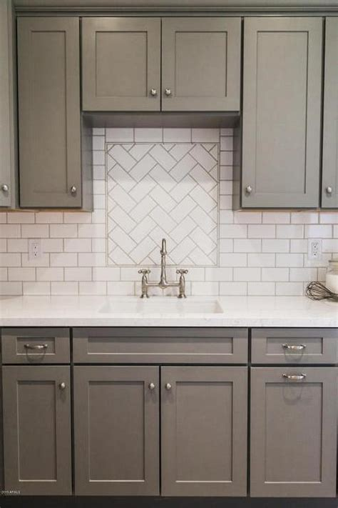 White Tile Backsplash Kitchen Gray Shaker Kitchen Cabinets With White Subway Tile Herringbone Sink Backsplash Transitional