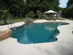 free formed pool and travertine patio design this patio