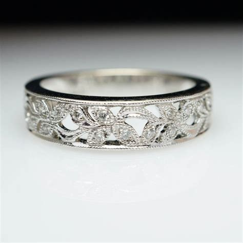intricate flower inlay white gold anniversary band
