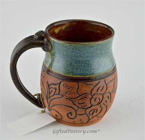 Handmade Ceramic Mugs - handmade pottery mug teal w carved brown flowers clay